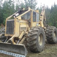 1986 Caterpillar 518 Swing Boom Grapple Skidder
