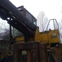 XL 235 Husky Knuckleboom Loader